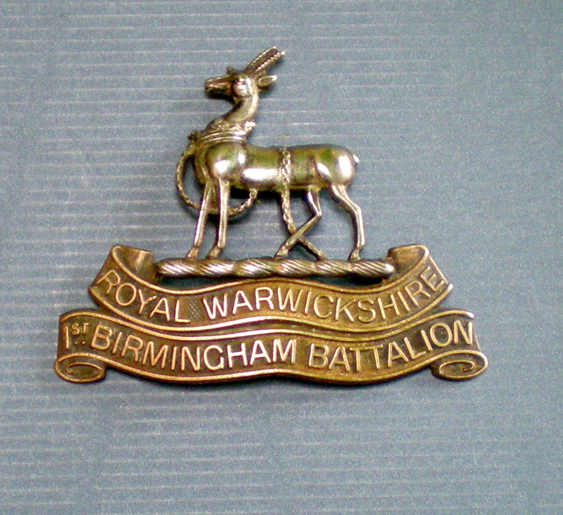 1st Warwicks cap badge